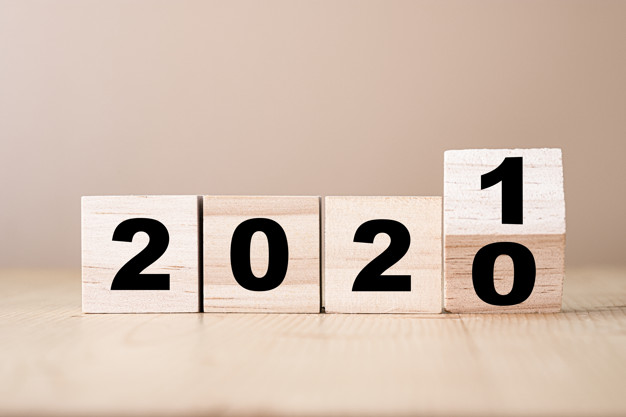 Hand flipping wooden blocks for change year  2020 to 2021 . New